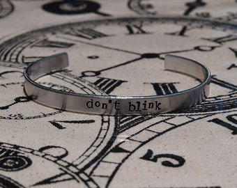 DON'T BLINK - Doctor Who Inspired Aluminum Bracelet Cuff - Hand Stamped