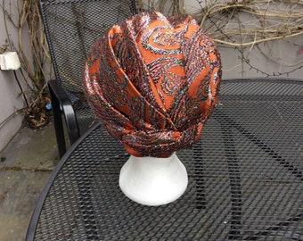 Burnt orange brocade turban with twinkly embroidery USA 1950s