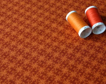 """Kaleidoscope"" graphic orange patchwork fabric"