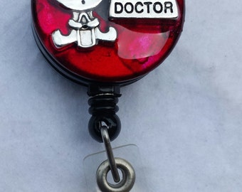 Pediatrician or pediatric doctor name badge holder with a multicolor background and child holding a bottle detail
