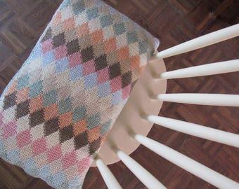 Hooked harlequin cushion