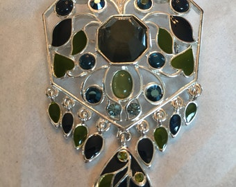 Silvertone pin with dangle accents. Nice colors