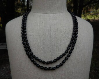 Vintage 1950s to 1960s Jet Black Faceted Glass Beaded Double Strand Necklace Gold Tone and Iridescent Glass Clasp Retro