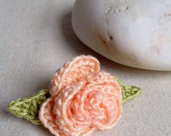Pink crochet flower brooch