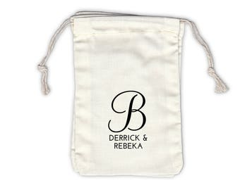 Script Monogram and Names Personalized Cotton Bags for Party or Wedding Favors in Black - Ivory Fabric Drawstring Bags - Set of 12 (1047)