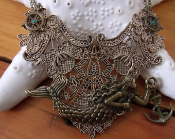 handmade mermaid bib necklace with ships wheels and anchor