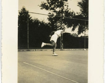 vintage photo Vernacular Snapshot Tennis Woman Leans into her Serve on Court