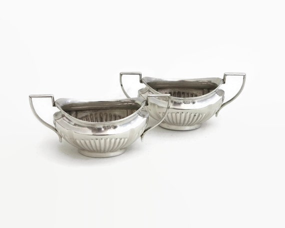 2 antique sterling silver salt cellars with ribbed sides and interesting handles, made in England, 1904, Edwardian, 47 grams