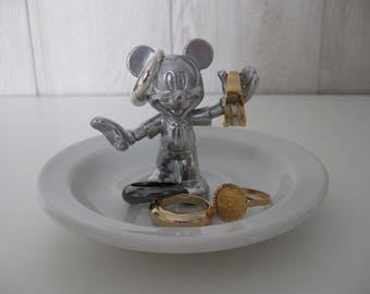 with its silver figurine jewelry dish
