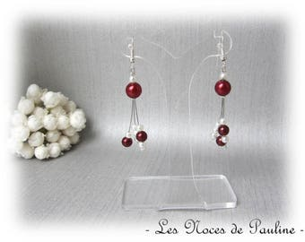 Has Burgundy and ivory three asymmetrical dangle earrings