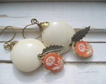 Almond Breeze dangle earrings, cream Lucite, peach cabs, brass leaf drop earrings
