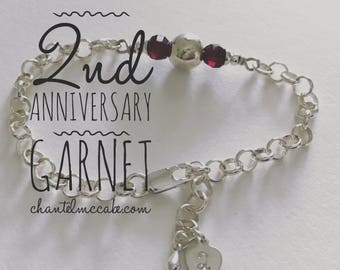 Garnet second anniversary adjustable length bracelet in sterling silver with stamped charm, Perth Western Australia