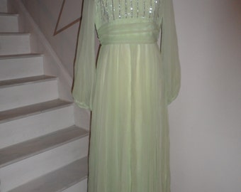 jack bryan mint green sheer sleeves and flowing overlay beaded bodice gown