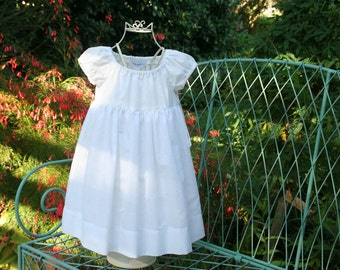 Baptism   Flower girl    White lined girls dress  Available in sizes 3 months 1T 2T 3T 4T 5 6 7 and 8