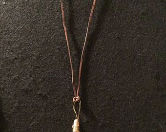 Red pottery shard pendant on leather