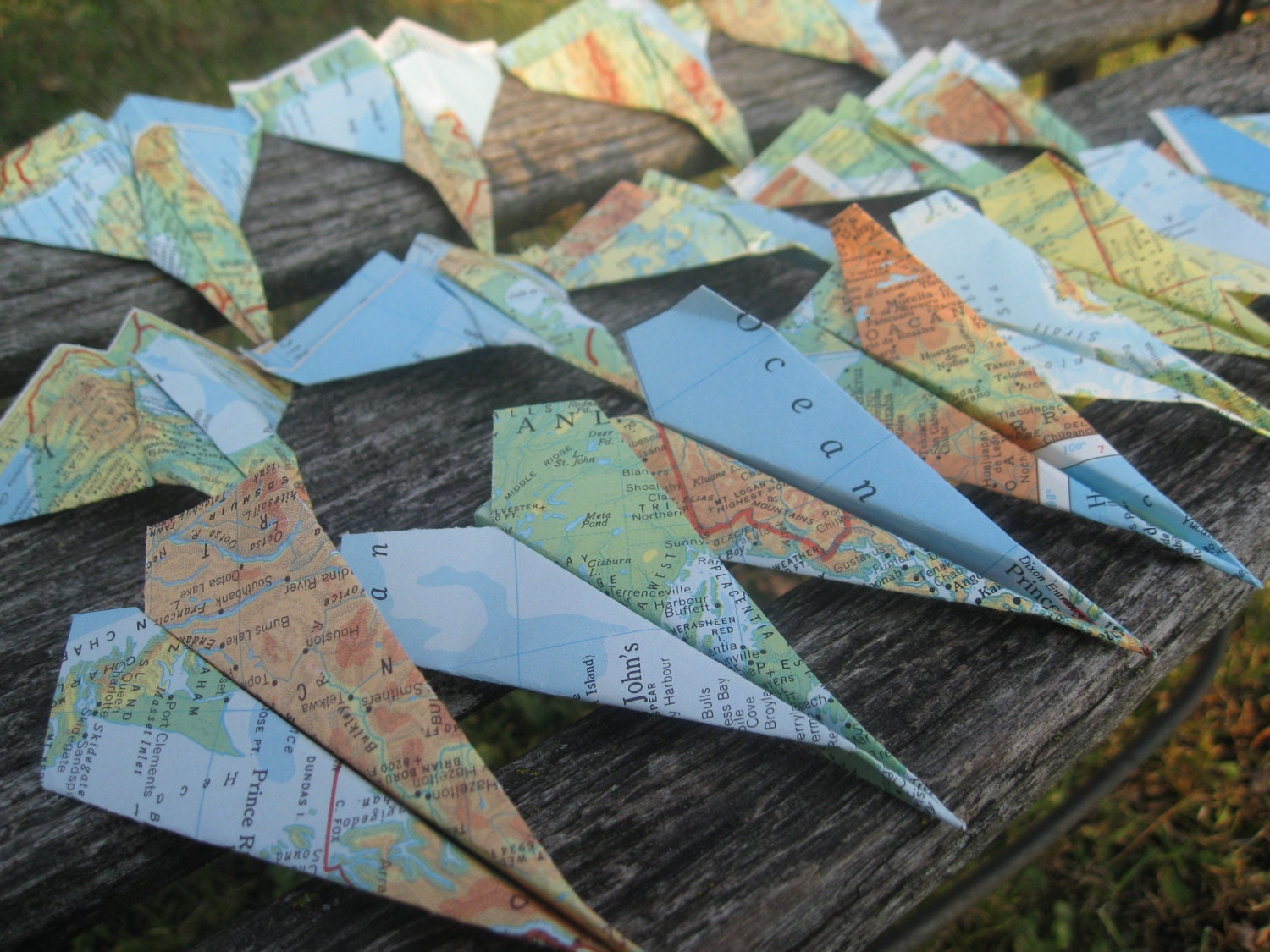 Vintage map paper airplanes escort cards wedding decoration zoom jeuxipadfo Choice Image