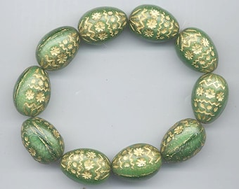 Four Czech glass beads - swirled satiny green with embossed gold design - 19 x 14 mm