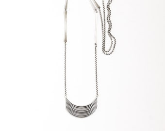 """Long boho style sterling silver necklace with a unique pendant handmade by joining flattened and curved silver wires - """"Tribe Necklace"""""""