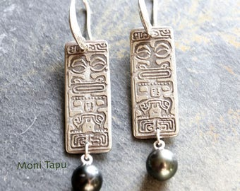 Tahitian pearl earrings with etched sterling tiki design