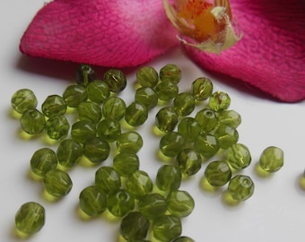 set of 50 beads a faceted olive green glass looks like