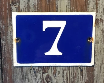 Vintage French enamel house number - number 7. Traditional light blue and white.