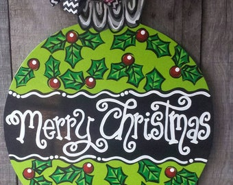 Merry Christmas wooden.door hanger with Holly leaves and berries