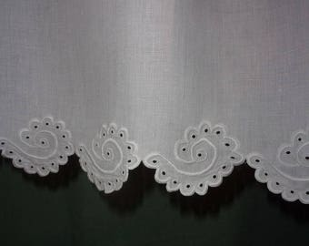 A curtain valance, or old beautiful embroidery done by hand