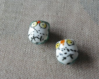 A ceramic hand-painted, OWL bead emerald green