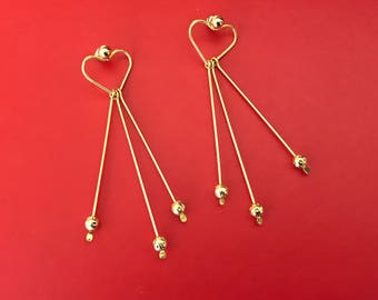 Lovely Huge Heart Pierced Earrings With Dangling Wires With Beads