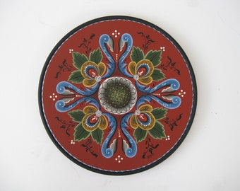 Norwegian Rosemaling on a 12 inch beaded plate