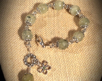 Beautifully Polished Light Green Prehnite Stones, Antiqued Silver Flower Bead Caps, Crystal Spacers, Crystal Flower Charm 7.5 Inch Bracelet
