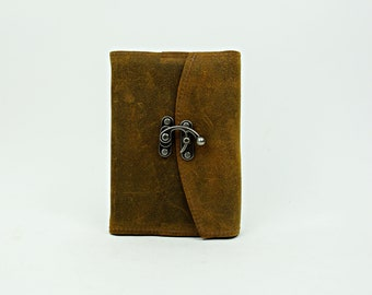 Refillable leather journal with latch closure