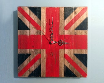 Wall clock made with recycled wood reproducing the Union Jack, the UK red, blue and white flag