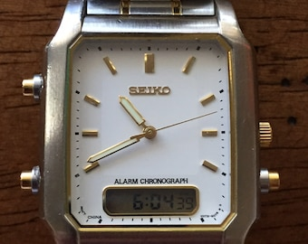 Vintage Sieko mens alarm chronograph lcd/analog VO72-5075 stainless/gold 2-tone watch c1990s