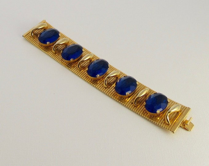 Fun and Fabulous Gold Tone Blue Glass Bracelet; Wide Gold Tone Bracelet; Flexible Gold Tone Bracelet; Wide Bracelet with Blue Glass