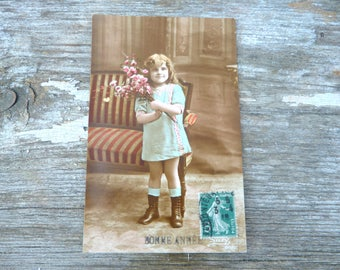 Vintage 1900s recolored French postcard  adorable girl with a bouquet