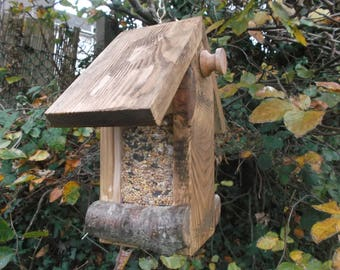 Hanging wild small bird seed feeder