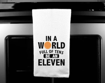 In a world of tens, be an eleven/kitchen towel/funny kitchen towel/stranger things/eleven/christmas gift/birthday present/housewarming gift