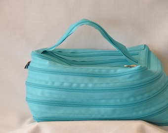 Turquoise toiletry bag entirely in French brand zipper