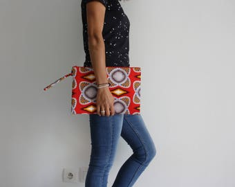 Maxi clutch made of wax with beautiful prints in shades of Red