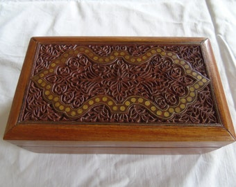 Wooden box with hand carved lid and brass inlay, possibly from India