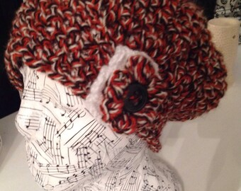 Ladies hand made slouch hat with motif in rust,white & black