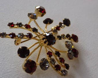 Stunning Austrian red,grey, and black faceted crystal brooch, marked Made in Austria