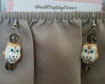 Tan owl dangle earrings
