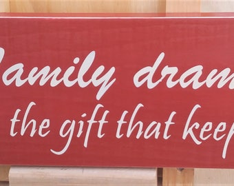 Family drama the gift that keeps on giving wooden sign