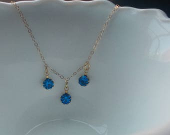 Vintage Swarovski crystals on  14kt gold filled chain necklace