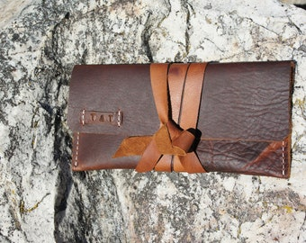 Rustic oil tanned leather pouch with wrap around ties