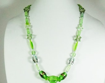 Handmade lampwork beads, green and crystal clear.