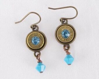 Earrings-Bullet casing Winchester 9mm-Swarovski Blue crystal-blue crystal dangles-brass earring finding-Brass bezel-gun jewelry-bullet