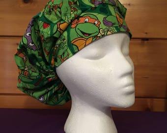 Women's adjustable bouffant surgical scrub hat.